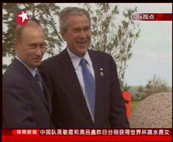 握个手,来个化干戈为玉帛 普京和布希