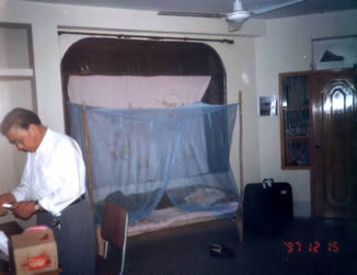 This our bedroom, three men live in a room, put up a mosquito net above the plank bed